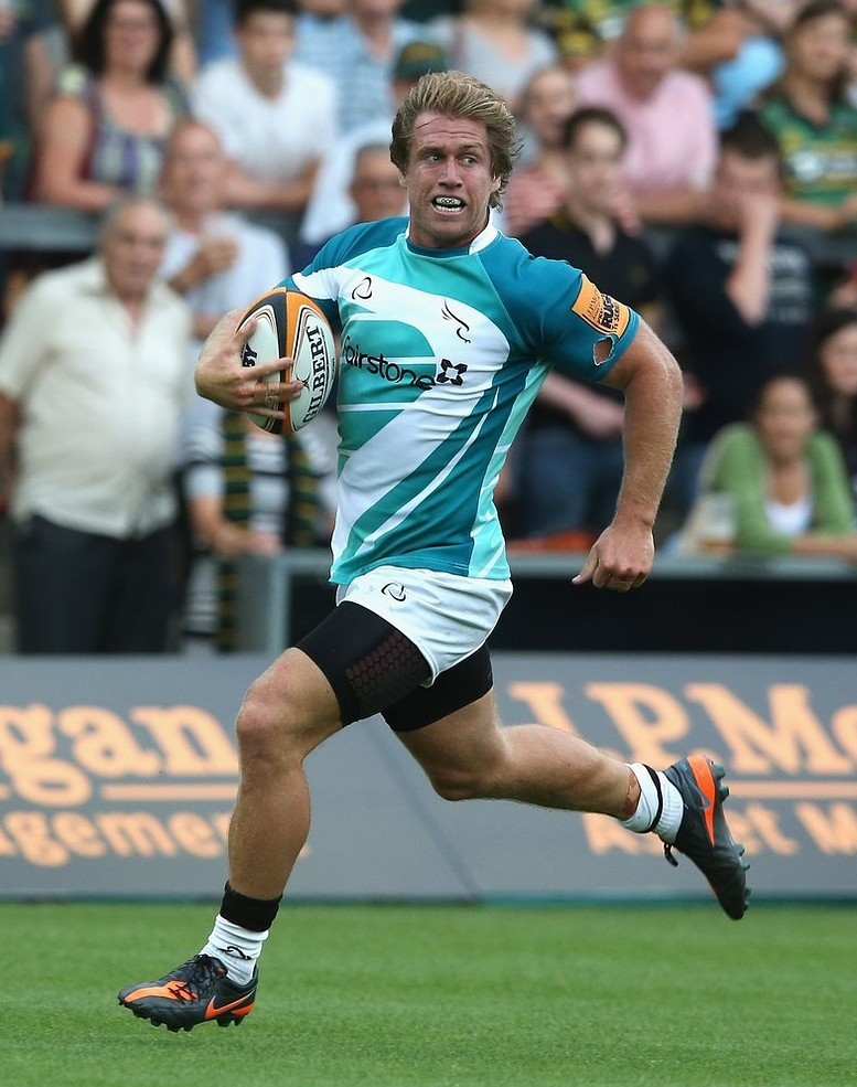 NORTHAMPTON, ENGLAND - AUGUST 02: Richard Mayhew of the Newcastle Falcons runs with the ball during the J.P.Morgan Asset Management Premiership 7's at Franklin's Gardens on August 2, 2013 in Northampton, England. Getty Images