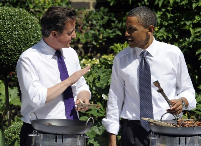 US President Barack Obama (R) and Britain's Prime Minister David Cameron speak as they serve a barbecue during an event hosted by Samantha Cameron and First Lady Michelle Obama to honor military families from US and Britain service members and veterans at 10 Downing Street in London, on May 25, 2011.  Obama and his wife Michelle enjoyed a regal welcome from Queen Elizabeth II, who has met every US president but one since the 1950s. Obama's visit, the second stop on a European tour, comes as Britain seeks to prove its staying power despite fading military might and Washington looks to retool its decades-old alliance with Europe as a catalyst for global action. AFP Photo/Jewel Samad (Photo credit should read JEWEL SAMAD/AFP/Getty Images)