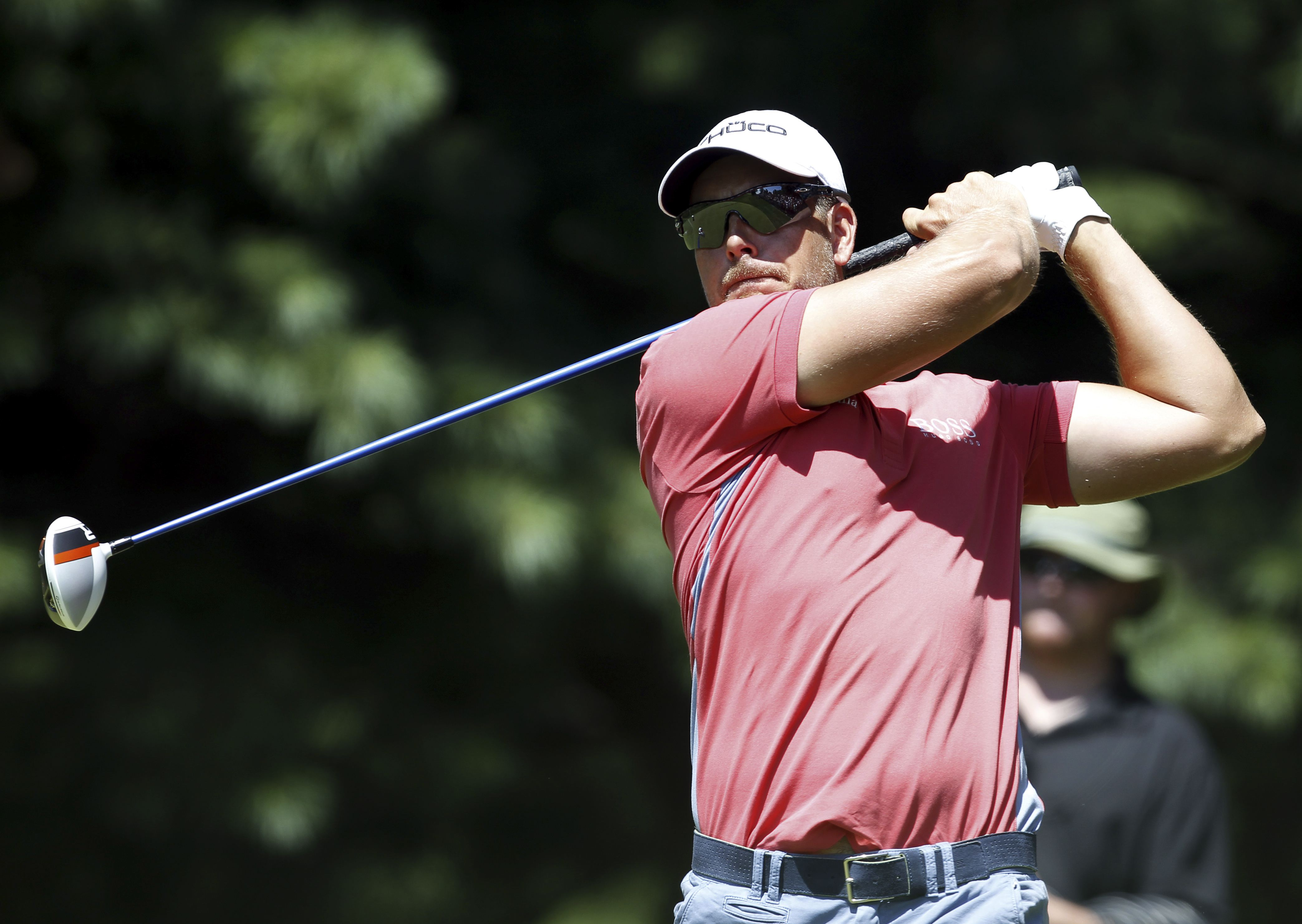 Henrik Stenson will edge out Tiger Woods and claim the US PGA title