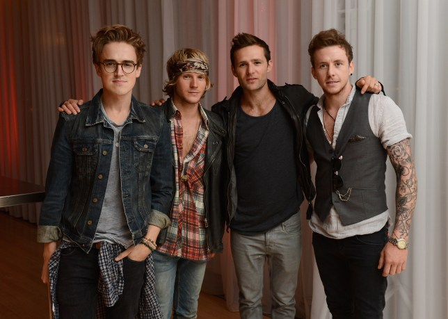 Cheeky: McFly lads take each other by surprise (Picture: Ian Gavan/Getty Images for Sony Pictures)