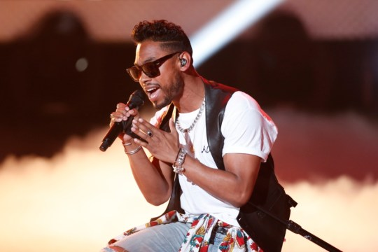 Singer Miguel performs before accepting the Best Male Artist Award