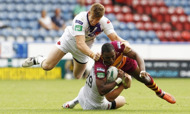 Rugby League - Huddersfield Giants v Salford City Reds - Super League - John Smith's Stadium - 4/8/13  Huddersfield Giants' Jermaine McGillvary (R) in action with Salford City Reds' Jordan Walne (C) and Adam Walne  Mandatory Credit: Action Images / Craig Brough  Livepic