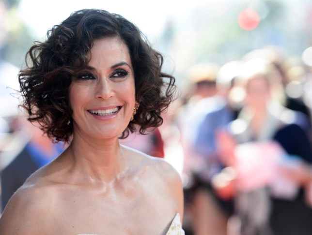 """Actress Teri Hatcher arrives on the red carpet of the world premiere of Disney's """"Planes"""" at the El Capitan Theatre, Monday, Aug. 5, 2013, in Los Angeles. (Photo by Dan Steinberg/Invision/AP)"""
