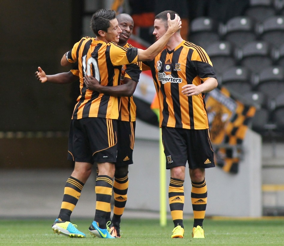 Football - Hull City v Real Betis - Andy Dawson Testimonial - Pre Season Friendly - The Kingston Communications Stadium - 10/8/13  Sone Aluko (C) celebrates with Robert Koren (L) and Robbie Brady after scoring the second goal for Hull City  Mandatory Credit: Action Images / Ed Sykes  Livepic