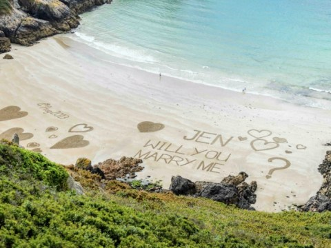 It's a shore thing as lover writes proposal in the sand