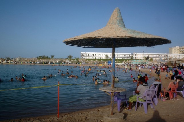 Egyptians enjoy the public beach along the Red Sea resort of Hurghada, in southern Egypt, on June 23, 2010, which attacks hundreds of thousands of tourists all year round. Egypt's oil minister Sameh Fahmi has said the government is considering reducing drilling in the Gulf of Suez after crude washed ashore for several days, a state-owned newspaper reported. AFP PHOTO/STR (Photo credit should read STR/AFP/Getty Images)