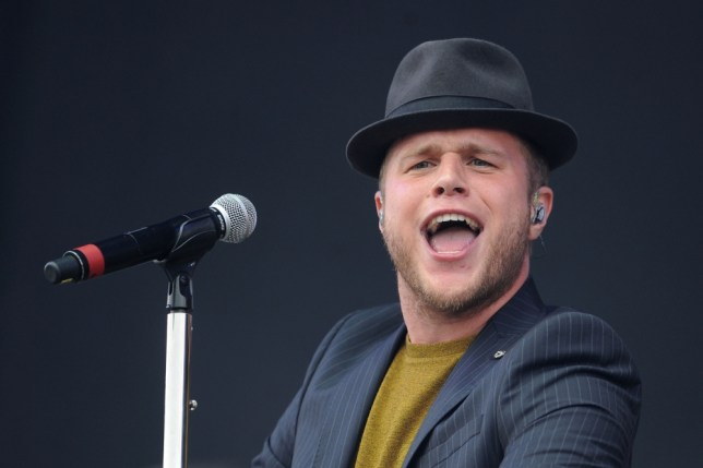 Olly Murs performs on the Virgin Media stage during day one of the V Festival at Weston Park in Weston-under-Lizard. PRESS ASSOCIATION Photo. Picture date: Saturday August 17, 2013. Photo credit should read: Joe Giddens/PA Wire