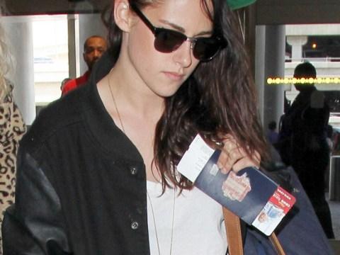 Kristen Stewart glum as her ex Robert Pattinson moves away from their Hollywood Hills neighbourhood
