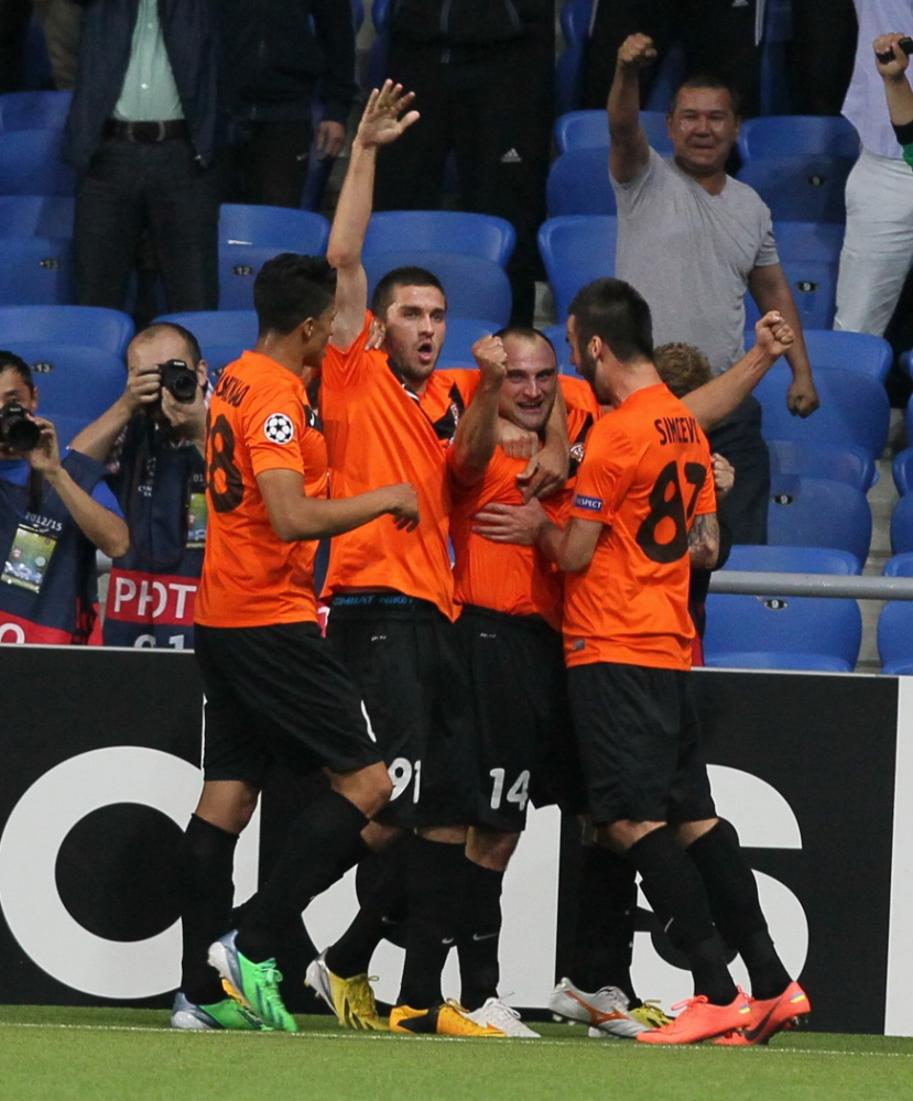 Shakhter's Sergei Khizhnichenko, second left, and Andrei Finonchenko, second right, who both scored goals, celebrate with team players  on their victory against Celtic during their Champions League playoff first leg soccer match in Astana, Kazakhstan, Tuesday, Aug. 20, 2013. (AP Photo/Alexei Filippov)