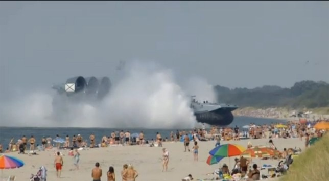 beach-2.jpg beach-1.jpg A huge military hovercraft has made an unexpected landing on a packed beach in Russia. Hundreds of people were sunbathing on the beach when the vessel powered towards them. No one was injured, although witnesses said beachgoers were surrounded by paratroopers and asked to move on. Grabs from http://news.sky.com/story/1131602/russian-navy-hovercraft-lands-on-busy-beach by Richard Taylor