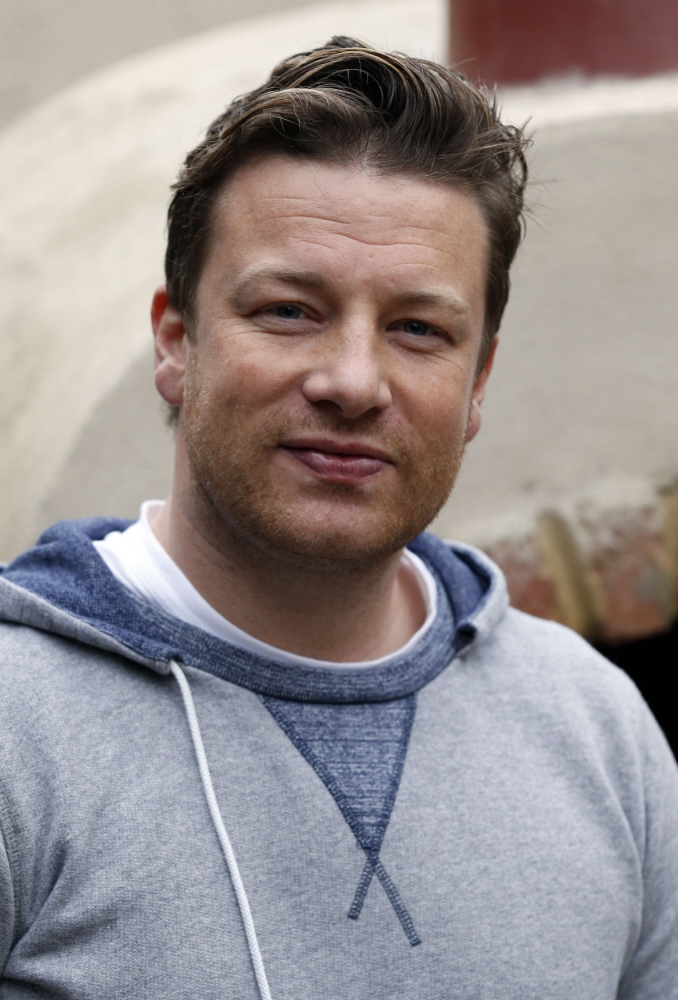 """Embargoed to 0001 Tuesday August 27. File photo dated 20/05/13 of Jamie Oliver as most of the poorest families in Britain do not know how to feed themselves properly and choose expensive rather than cheap options, according to the TV chef. PRESS ASSOCIATION Photo. Issue date: Tuesday August 27, 2013. The star, 38, who has an estimated fortune of £150 million, said that he finds it """"hard to talk about modern-day poverty"""". He cited a family he met while making one of his previous TV shows who ate unhealthy, fast food but had splashed out on a huge TV. Oliver said that poor communities in other countries had a better grasp of good food. See PA story SHOWBIZ Oliver. Photo credit should read: Jonathan Brady/PA Wire"""