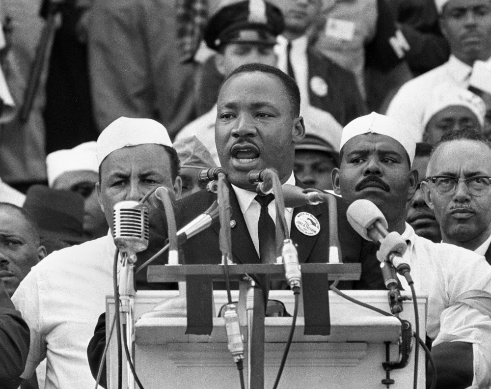 "FILE - In this Aug. 28, 1963, black-and-white file photo, Dr. Martin Luther King Jr., head of the Southern Christian Leadership Conference, addresses marchers during his ""I Have a Dream"" speech at the Lincoln Memorial in Washington. President Barack Obama's presence at the ceremony, Wednesday, Aug. 28, 2013, celebrating the 50th anniversary of the March on Washington, will embody the dreams of the 250,000 people who rallied there decades ago for racial equality ó and the continuing struggle by others for that goal. (AP Photo/File)"