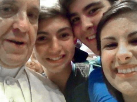 Holy selfie: Pope Francis strikes a pose for teen pilgrims