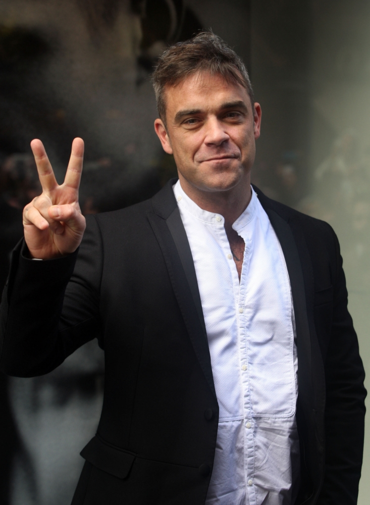 Robbie Williams launches the Autumn/Winter 2012 Farrell menswear collection in Glasgow city centre.  PRESS ASSOCIATION Photo. Picture date: Wednesday September 12, 2012. Photo credit should read: David Cheskin/PA Wire