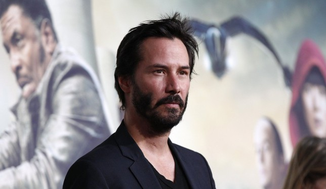 Keanu wonders what he'd look like with bat ears (Picture: Reuters)