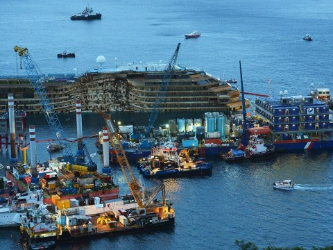 Costa Concordia upright after groundbreaking 19-hour operation