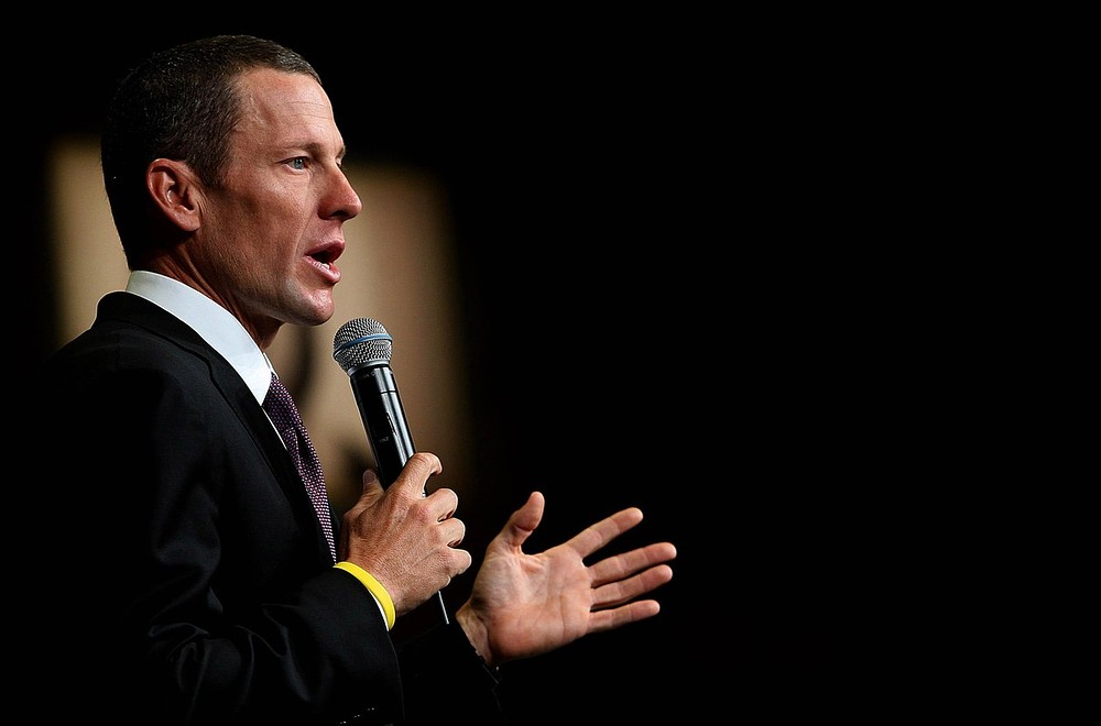 Lance Armstrong gives his Olympic medal back