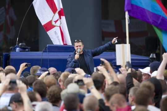 Tommy Robinson speaks to his followers at a protest in central London (Picture: AFP/Getty Images)