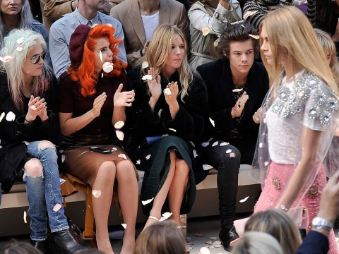 One Direction hunk Harry Styles declares 'Cara Delevingne is not my girl' at London Fashion Week Burberry show