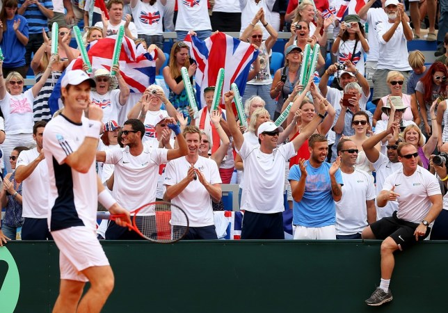 UMAG, CROATIA - SEPTEMBER 15:  Andy Murray of Great Britain celebrates winning against Ivan Dodig of Croatia as Colin Fleming, James Ward, Jonny Marray and Dan Evans celebrate during day three of the Davis Cup World Group play-off tie between Croatia and Great Britain at Stadion Stella Maris on September 15, 2013 in Umag, Croatia. Getty Images