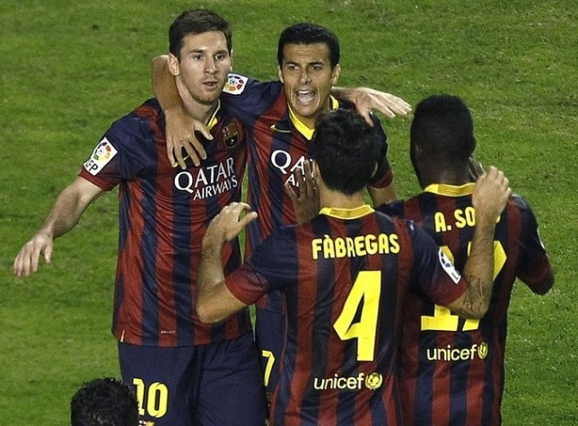 Just champion: Barcelona celebrate Pedro's opener at Rayo (Picture: AP)
