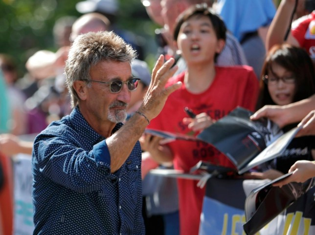 Former race driver Eddie Jordan of Ireland arrives at the track ahead of the third practice session of the Singapore F1 Grand Prix at the Marina Bay street circuit in Singapore (Picture: Reuters)