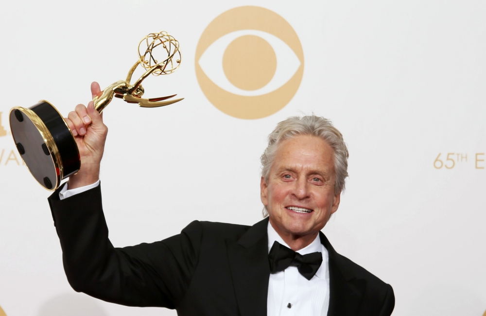 "Actor Michael Douglas from HBO's movie ""Behind the Candelabra"" poses backstage with his award for Outstanding Lead Actor In A Miniseries Or A Movie at the 65th Primetime Emmy Awards in Los Angeles September 22, 2013. (Picture: Reuters)"
