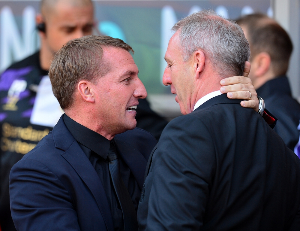 Liverpool manager Brendan Rodgers (left) and Sunderland caretaker manager Kevin Ball (right) greet each other before kick off