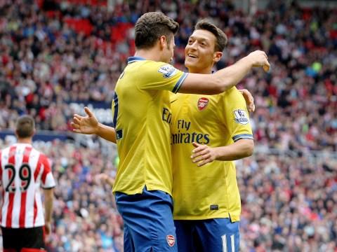 Mesut Ozil debuts as Aaron Ramsey helps Arsenal gun down Sunderland