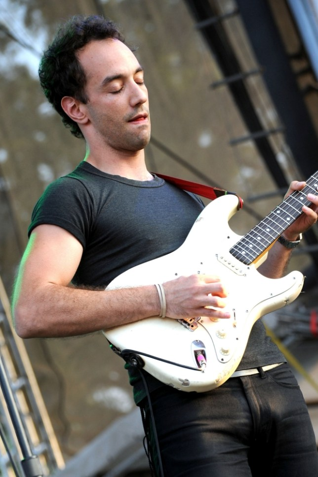 MANCHESTER, TN - JUNE 12:  Albert Hammond, Jr. of The Strokes performs on stage during Bonnaroo 2011 at Which Stage on June 12, 2011 in Manchester, Tennessee.  (Photo by Jeff Kravitz/FilmMagic)