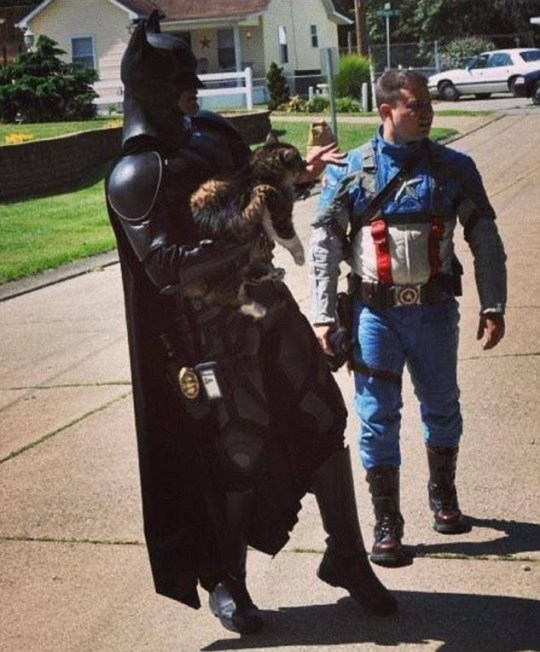 Two men dressed as superhoes saved a cat from dying in a burning West Virginia home Saturday. Batman and Captain America, aka John Buckland and Troy Marcum, had been working a children's event nearby when they saw smoke engulfing the Milton home. The dynamic duo rushed to see if anyone was inside the home and that's when they foudn the lucky kitty.