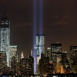The Tribute in Light rises above the lower Manhattan skyline and Four World Trade Center, center, and One World Trade Center, left, in a test of the memorial light display, Monday, Sept. 9, 2013 in New York. The twin beams of light will also appear Wednesday, Sept. 11, twelve years after the terrorist attacks of Sept. 11, 2011. (AP Photo/Mark Lennihan)
