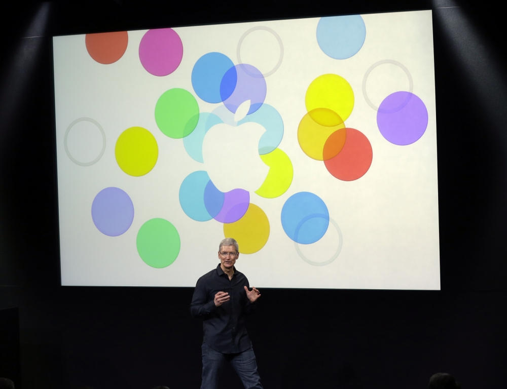 Tim Cook, CEO of Apple, speaks on stage before the introduction of new products in Cupertino, Calif., Tuesday, Sept. 10, 2013. Appleís latest iPhones will come in a bevy of colors and two distinct designs, one made of plastic and the other that aims to be ìthe gold standard of smartphonesî and reads your fingerprint. (AP Photo/Marcio Jose Sanchez)