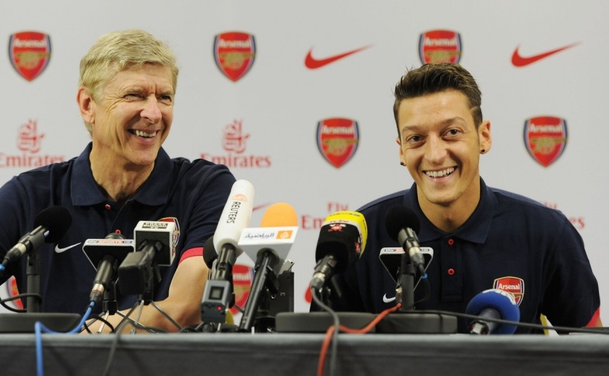 ST ALBANS, ENGLAND - SEPTEMBER 12: (EXCLUSIVE COVERAGE) (MINIMUM APPLY - 150 GBP PRINT & 75 GBP ONLINE OR LOCAL EQUIVALENT, PER IMAGE)  Arsenal manager Arsene Wenger with new signing Mesut Oezil attend a press conference at London Colney on September 12, 2013 in St Albans, England.  (Photo by Stuart MacFarlane/Arsenal FC via Getty Images)