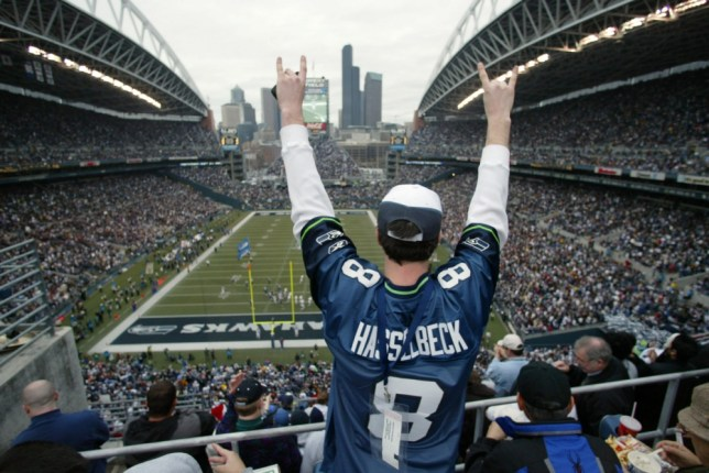 Seattle Seahawks fan Tommy Blevens of Federal Way, Wash.,celebrates the first touchdown for the Seasawks against the Indianapolis Colts during the first quarter of their  NFL football game in Seattle, Saturday, Dec. 24, 2005.  (AP Photo/John Froschauer)