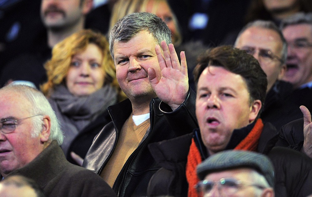 WEST BROMWICH, ENGLAND - NOVEMBER 19: TV presenter Adrian Chiles waves from the crowd before the Barclays Premier League match between West Bromwich Albion and Bolton Wanderers at The Hawthorns on November 19, 2011 in West Bromwich, England. Getty Images
