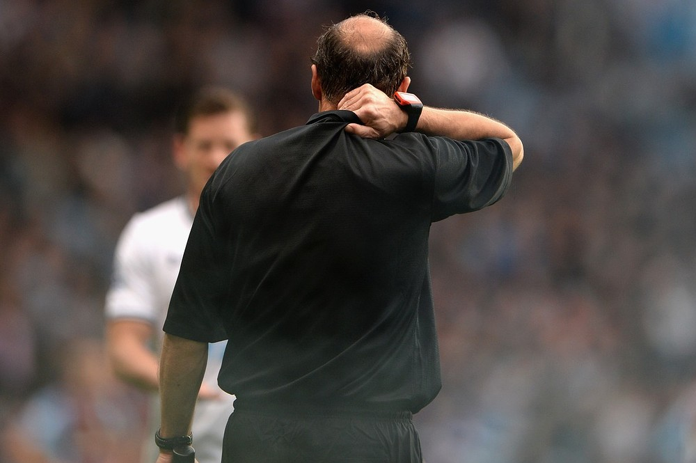 Smoke bomb thrown by Spurs fan hits linesman during Aston Villa-Tottenham clash
