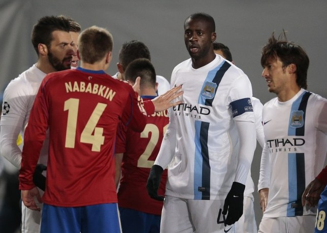 Yaya Toure speaks to players from CSKA after complaining about racist chants (Picture: AP)