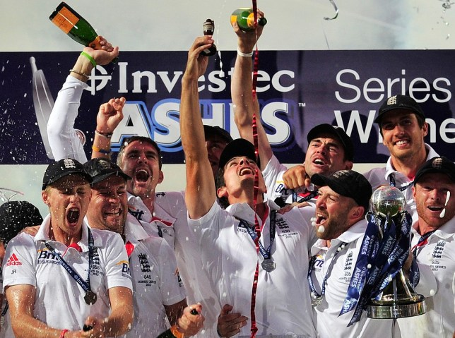 England's Alastair Cook (C) lifts a replica of the Ashes Urn amid his team mates as they celebrate their series win after drawing on the final day of the fifth Ashes cricket test match between England and Australia at the Oval in London on August 25, 2013. England and Australia drew the fifth Ashes Test at The Oval on Sunday as the hosts wrapped up a 3-0 series win. AFP/Getty Images