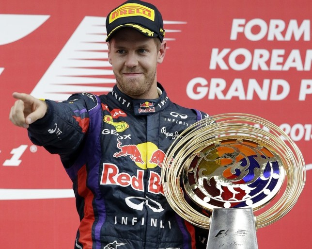 Red Bull driver Sebastian Vettel of Germany gestures as he celebrates on the podium after winning the Korean Formula One Grand Prix at the Korean International Circuit in Yeongam, South Korea, Sunday, Oct. 6, 2013. AP