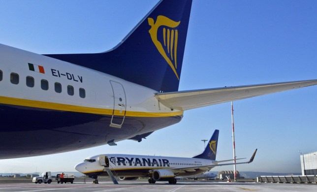 (FILES) - A file picture taken on November 8, 2006 shows two Irish low-cost airline Ryanair Boeing 737-800 parked on the tarmac of the MP2 (Marseille-Provence) airport in Marignane, southern France, where Ryanair has its French hub. The French Aix-en-Provence criminal court will deliver a verdict on October 2, 2013, judging if Ryanair broke French social legislation by employing its 127 employees of its Marseille base under Irish contracts.    AFP PHOTO/ANNE-CHRISTINE POUJOULATANNE-CHRISTINE POUJOULAT/AFP/Getty Images