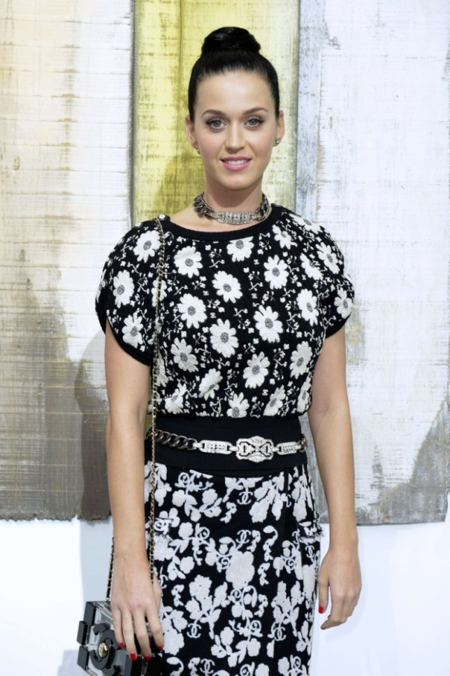 US singer Katy Perry poses before the Chanel 2014 Spring/Summer ready-to-wear collection fashion show, on October 1, 2013 at the Grand Palais in Paris.  AFP PHOTO / MIGUEL MEDINAMIGUEL MEDINA/AFP/Getty Images