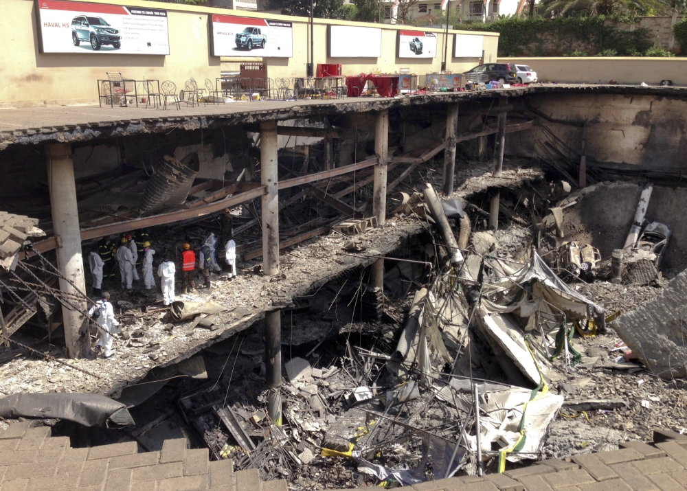 Nairobi attack: Charred bodies 'highly likely' to be gunmen as suspect identified
