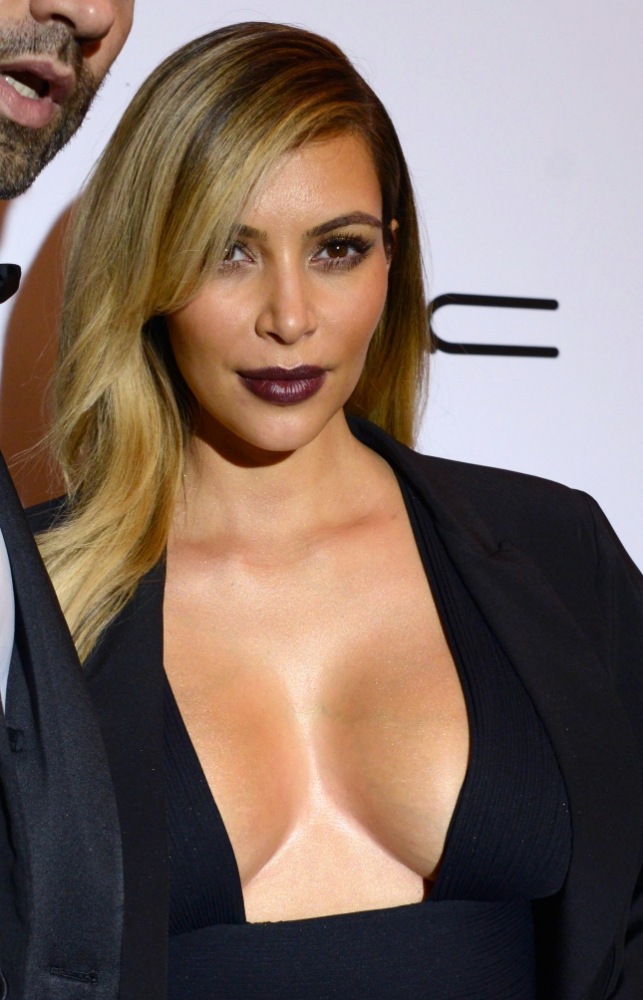 She's sexy and she knows it: Kim Kardashian shows off a whole lot of boob on night out in Paris
