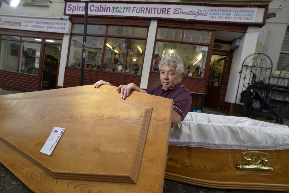 Chris Page of Spiral Cabin charity shop, Bedford Place, Brighton has a coffin for sale in his shop TA31013D4 PICTURE TERRY APPLIN Contact Chris Page 07922 098062