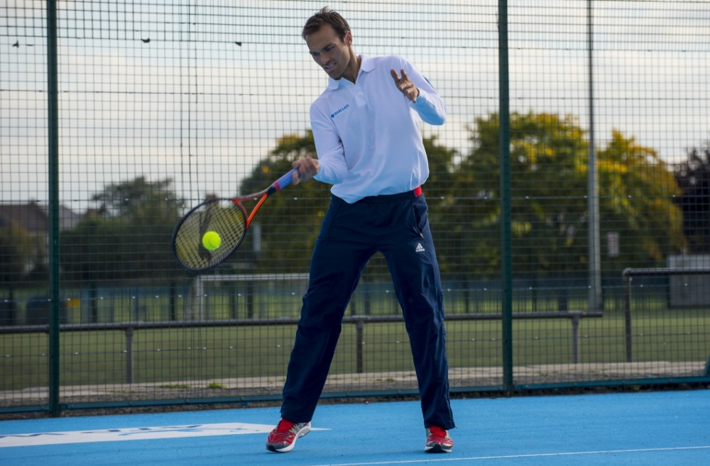 Senior tennis player Ross Hutchins plays at the opening of the newly refurbished White Hart Lane Sport Centre tennis courts that replicate the centre court at the Barclays ATP World Tour Finals which takes place at The 02 arena.  By Lucy Young  07799118984 lucyyounguk@gmail.com www.lucyyoungphotos.co.uk