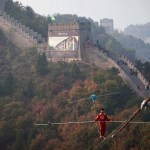 """Adili Wuxor (front), who is known as """"Prince of the Tightrope"""", and his apprentice walk on a tightrope above the Great Wall in Tianjin October 18, 2013. REUTERS/China Daily (CHINA - Tags: SOCIETY TPX IMAGES OF THE DAY) CHINA OUT. NO COMMERCIAL OR EDITORIAL SALES IN CHINA"""