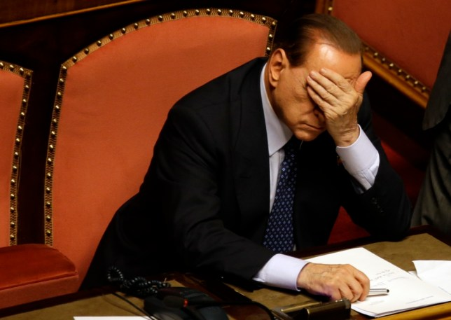 Silvio Berlusconi banned from parliament for two years over tax fraud