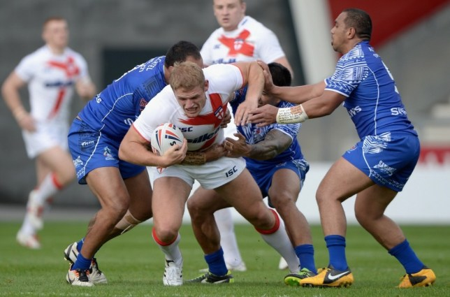 SALFORD, ENGLAND - OCTOBER 19:  Tom Burgress of England Knights is brought to ground by the Samoan defence during the International match between England Knights and Samoa at Salford City Stadium on October 19, 2013 in Salford, England.  (Photo by Gareth Copley/Getty Images)