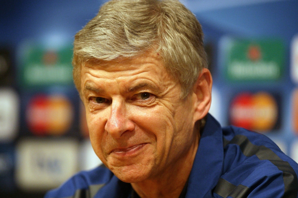 """File photo dated 7/3/11 of of Arsenal manager Arsene Wenger. PRESS ASSOCIATION Photo. Issue date: Monday October 21, 2013. Arsenal manager Arsene Wenger joked that everyone in football """"feared the worst"""" about what former Manchester United manager Sir Alex Ferguson might have to say about them in his forthcoming autobiography. See PA story SOCCER Ferguson Wenger. Photo credit should read: Dave Thompson/PA Wire."""